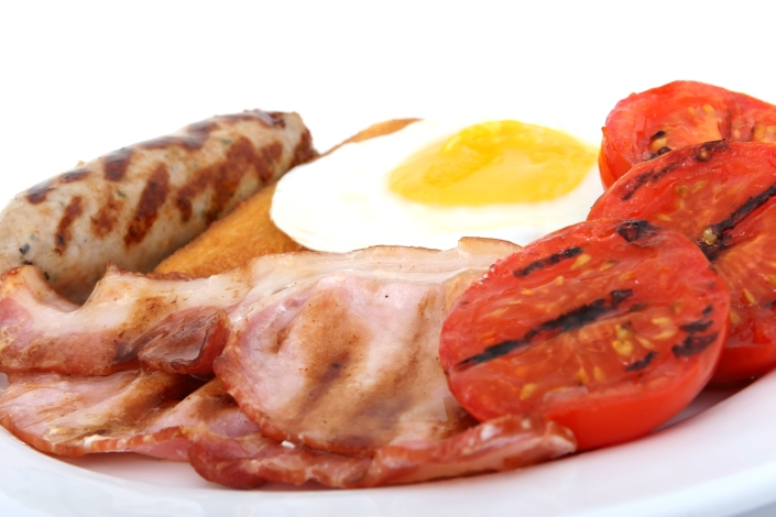 Sausage, bacon tomato and egg breakfast